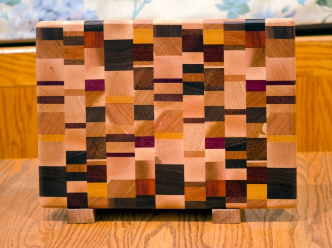 "Cutting Board 16 - End 021. Chaos board. Goncalo Alves, Cherry, Hard Maple, Hickory, Purpleheart, Yellowheart, Padauk, Jatoba & Black Walnut. End Grain. 10"" x 14"" x 1""."