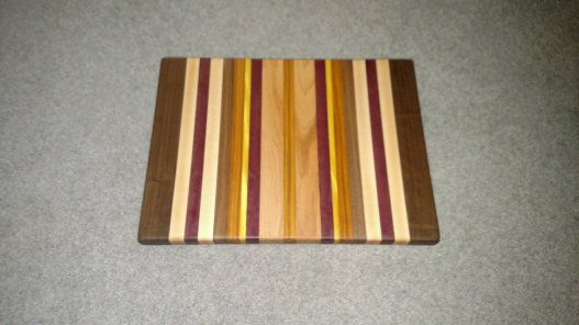 "Cutting Board 16 - Edge 006. Edge grain. Black Walnut, Hard Maple, Bloodwood, Canarywood & Yellowheart. 13-1/2"" x 18"" x 1-1/4""."