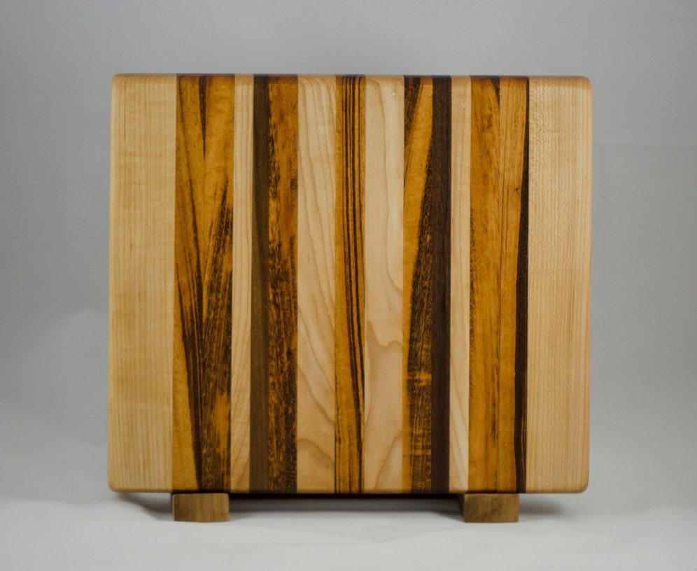 "Cutting Board 16 - Edge 014. Hard Maple, Goncalo Alves & Black Walnut. Edge grain. 13"" x 12"" x 1-1/2""."