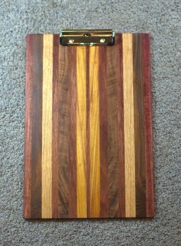 "Clipboard 16 - 014. Purpleheart, Quilted Black Walnut, Red Oak, & Canarywood. Legal size, 1/2"" clip. Commissioned piece."