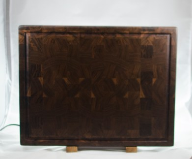 "Cutting Board 16 - End 034. Black Walnut. End Grain, Juice Groove. 16"" x 21-1/2"" x 1-1/2"". $350."