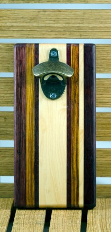 "Magic Bottle Opener 16 - 019. Wall mount. Purpleheart, Canarywood & Hard Maple. Approximately 5"" x 10"" x 3/4""."