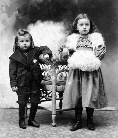 Cecil Alban Boring and Edna Mildred Lee Boring. Circa 1899. This is not the chair, and I have no idea what they are wearing!.