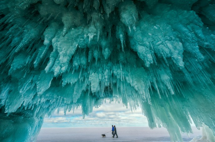 The ice caves at Apostle Islands National Lakeshore in Wisconsin. Accessible by foot when Lake Superior freezes over - which doesn't happen every year - the caves are like a palace decorated with hanging blue ice formations. Photo by Wan Shi. Posted on Tumblr by the US Department of the Interior, 8/3/16.