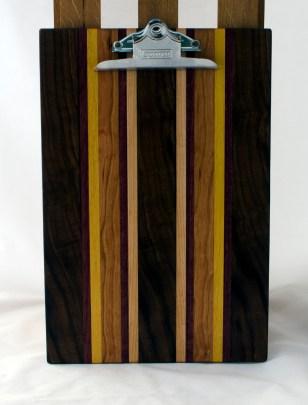 "Clipboard 16 - 028. Black Walnut, Purpleheart, Yellowheart, Cherry & Hard Maple. Legal size. 1"" clip."