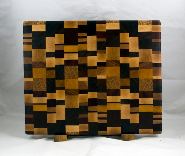"Cutting Board 17 -412. Chaos Board, End Grain. Cherry, Oak, Hard Maple, Black Walnut, Padauk, Hickory, Canarywood, Yellowheart, Purpleheart & Bloodwood. 13-1/2"" x 16"" x 1-1/4""."