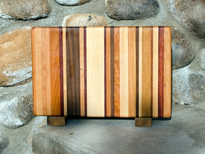 "Small Board 17 - 202. Chaos Board. Cherry, Jatoba, Hard Maple, Purpleheart & Bubinga. 7"" x 12"" x 3/4""."