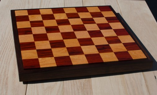 "Chess 17 - 303. Padauk & Honey Locust playing surface with a Black Walnut frame. 18"" x 18"" x 1-1/2"". Commissioned piece."