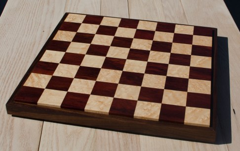 "Chess 17 - 304. Bloodwood & Birdseye Maple playing surface surrounded by a Black Walnut frame. 18"" x 18"" x 1-1/2"". Sold in its first showing."