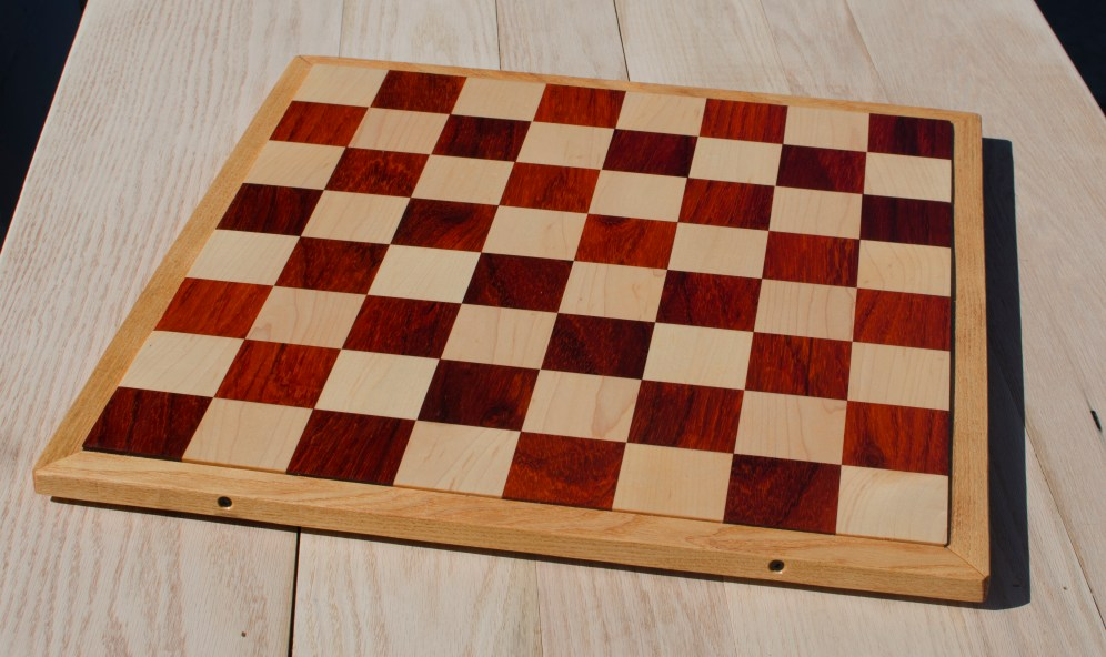 "Chess 17 - 305. Padauk & Hard Maple playing surface surrounded by a Honey Locust frame. 18"" x 18"" x 1""."