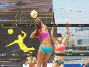 Ali McColloch attacking professional beach volleyball in New York City AVP