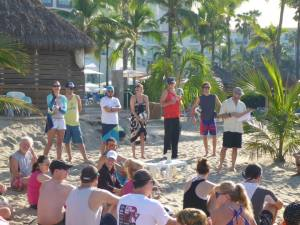 Coach Kevin McColloch teaching beach volleyball to 100+ adults in Puerto Vallarta