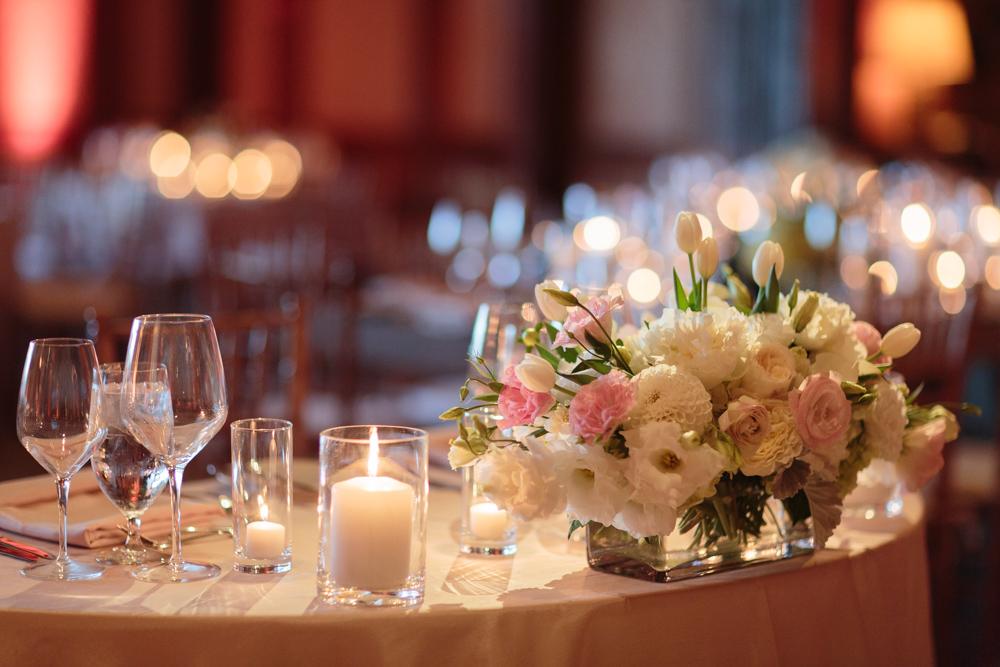 wedding centerpiece with white tulips, blush garden roses and white button dahlias