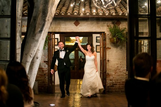 Bride and Groom walking into reception. Bride and Groom introducted for the first time. Carondelet House. Moxie Bright Events.