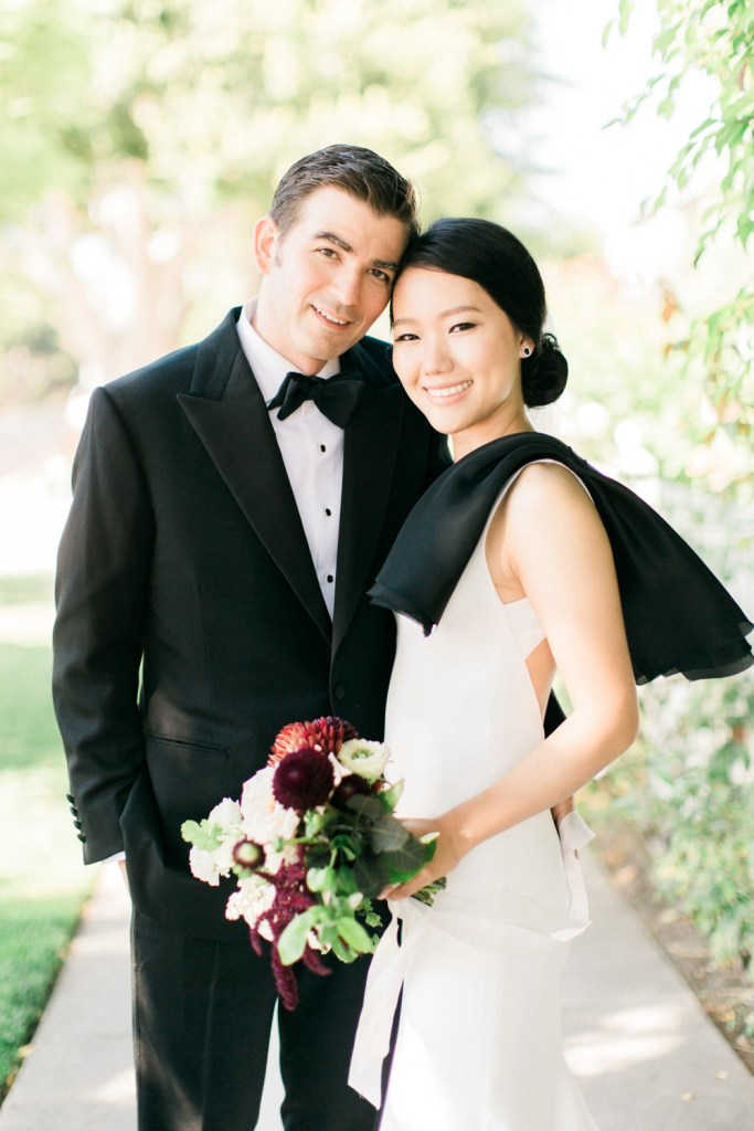 bride and groom, bride in Vera Wang dress with large black bow