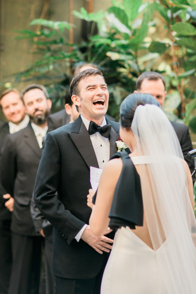 groom laughs at wedding ceremony Hinoki & the Bird, Moxie Bright Events