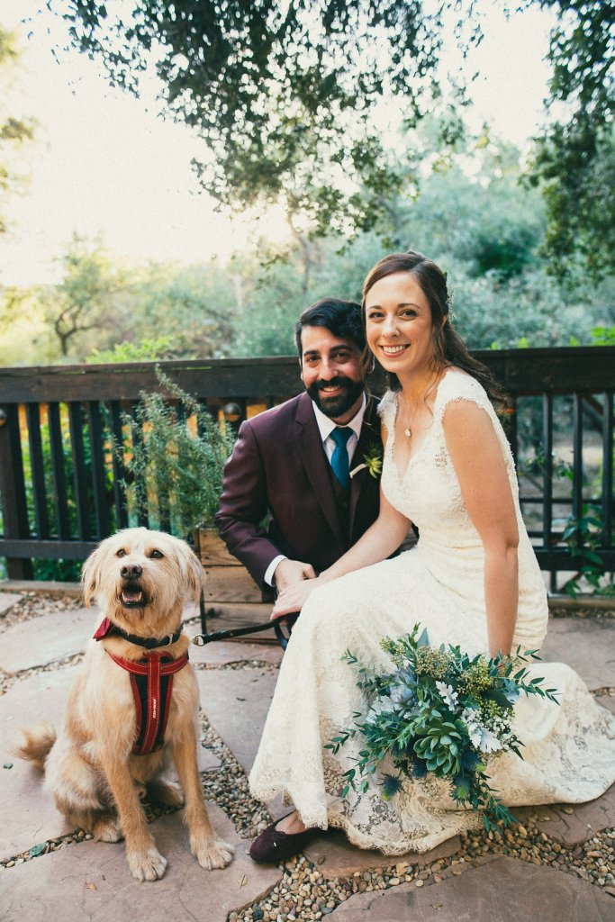 bride and groom and dog on wedding day