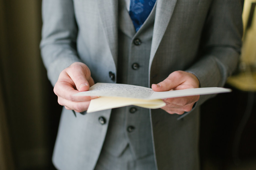 Groom reads note from Bride before Carondelet wedding ceremony