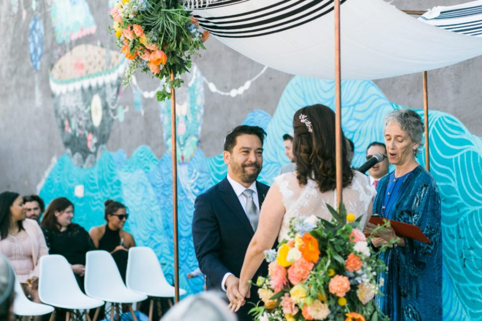 side angle wedding ceremony, mural at The Unique Space, DTLA