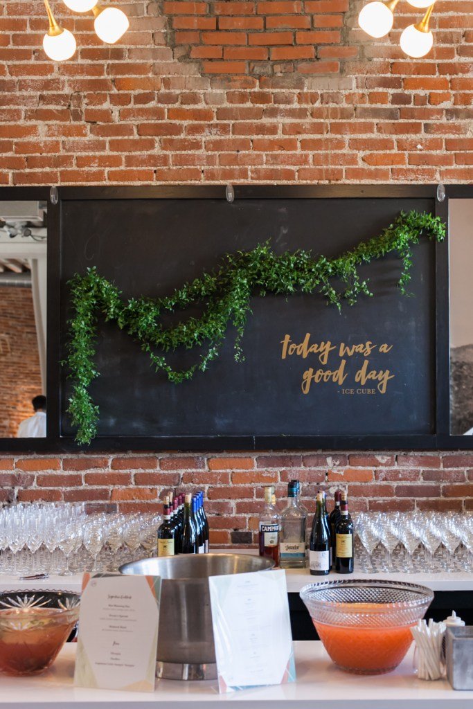 Black chalkboard with gold vinyl quote and garland