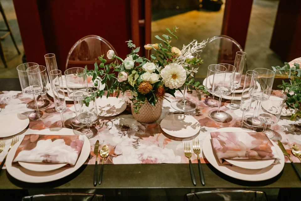 pink, grey, red, and white tablescape at Kim Sing Theatre