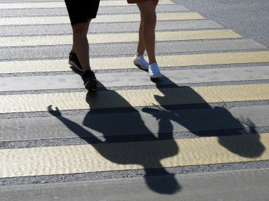Close up of the shadow of a couple holding hands as they walk to couples therapy in Orange County, CA. Moxie Family Therapy offers relationship counseling, marriage counseling, couples counseling, and more.