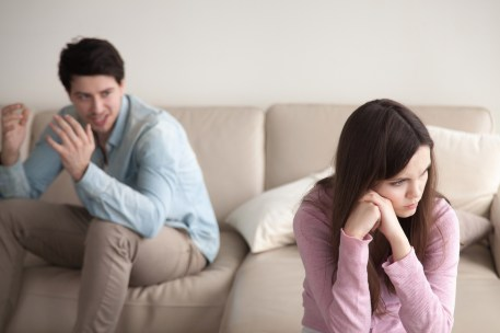 A couple face away from one another on either side of a sofa. They believe their relationship could benefit from marriage counseling in California. Moxie Family Therapy offers couples therapy and marriage counseling in Orange County, CA. Contact us to get in touch with a couples therapist today!