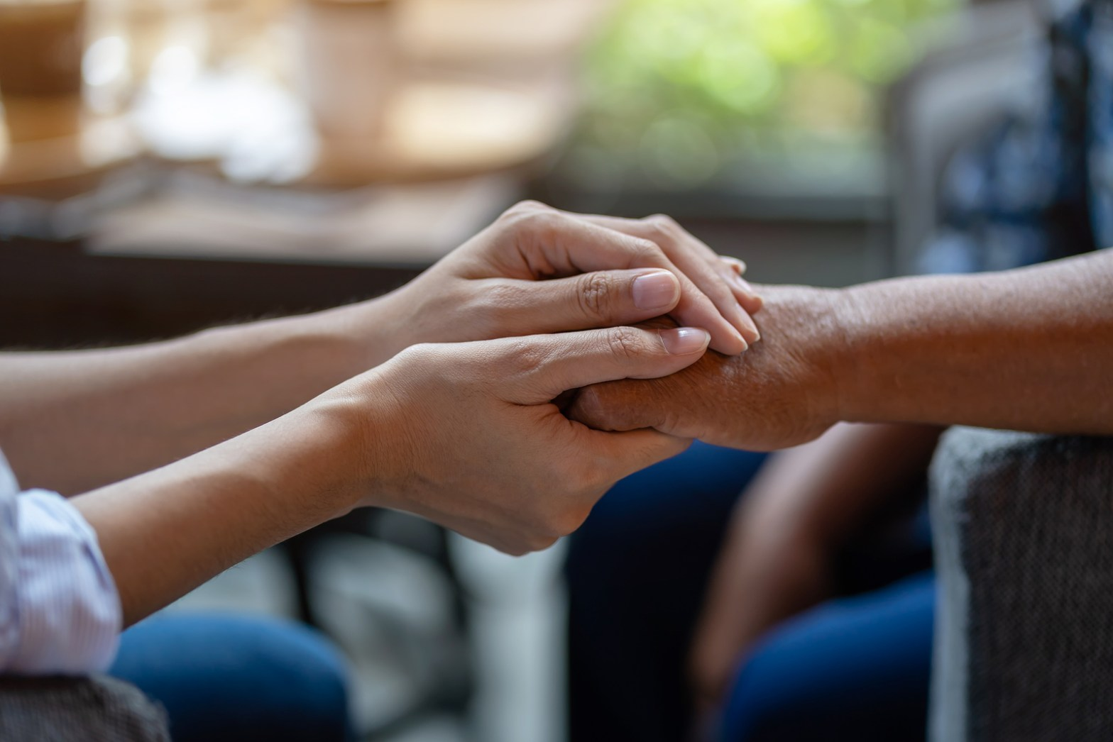 A hand supports the hand of a client sitting across from them. This could repersent how a therapist for a therapist in Orange County, CA can provide support to a fellow counselor. Learn about compassion fatigue treatmetn and how therapy fro therapists in Orange County, CA can help.
