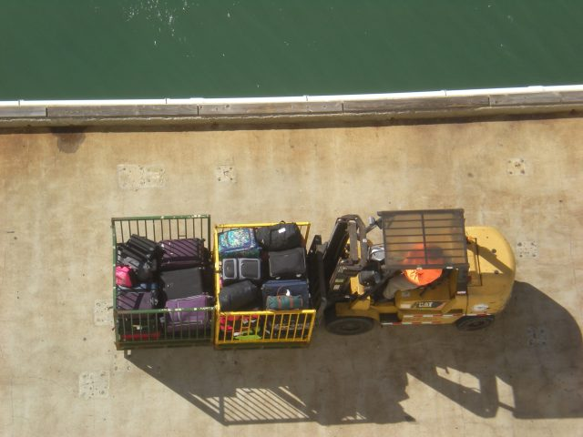 truck with the luggage waiting to be loaded onto the Carnival Cruise ship