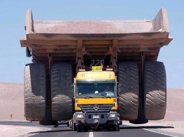 Merc long-hauler carries open pit dump truck, source: Mining.com