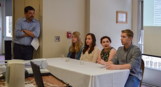 Scott Schlagel speaks about the importance of studying a foreign language at the International Week Language and Folklore event on April 10 in the Bovee UC.