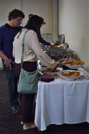 Students enjoy the hispanic finger food served at the International Week Language and Folklore event on April 10 in the Bovee UC.