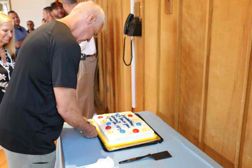 Lt. Korn cutting his cake.