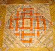Square of a cigar quilt in varying stages of disintegration.