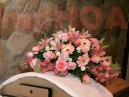 # MPCAK003 — $350.00 — Pink Cymbidium Orchid, Pink Asiatic Lilies, Pink Gerbera Daisies, Pink Roses, Pink Carnations, Pink Snap Dragons, White Pompoms. Approximate size: 18″H x 40″W