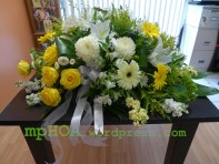 #MPCAS005 — $250.00. Yellow Roses, Yellow Gerbera Daisies, White China Mums, White Stocks, Whites Astroemerias, White Matsumoto Asters, White Oriental Lilies, White Gerberas, Yellow Stocks, Bell of Irelands, Solidagos. ~ Approximate size: 18″H x 36″W ~