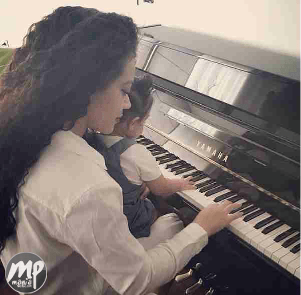 wp-1471536295193-1 Adorable Photo of Nadia Buari teaching one of her twin daughters to play the piano