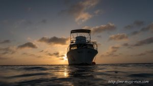 Diving ship in the sunset