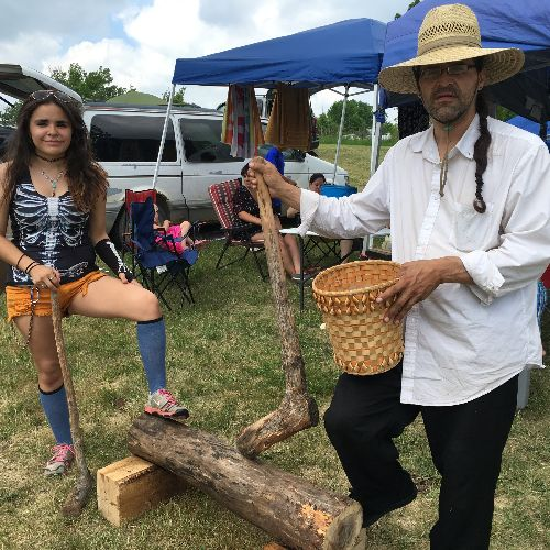 Clearwater County-based Indigenous artist Simon Zornes at the powwow grounds in Ogema showing how to pound a black ash log for use in basket making.