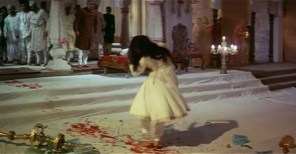 Leaving a trail of blood behind her, Pakeezah stumbles across the floor to the horror of onlookers.