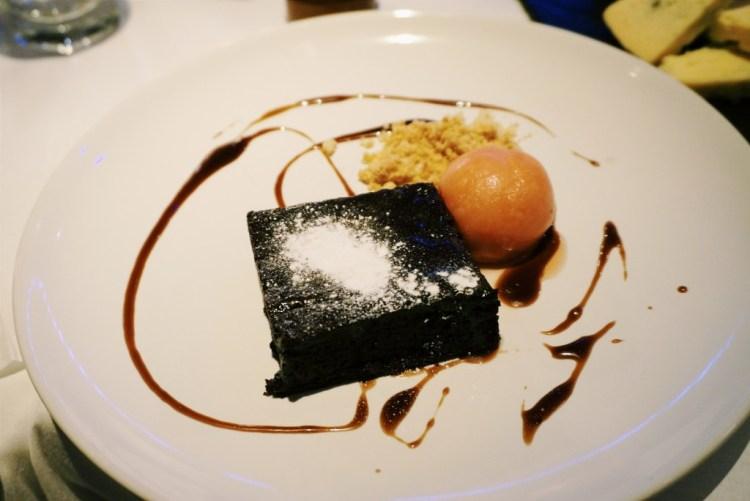 Warm brownie and blood orange sorbet dessert Northbank London