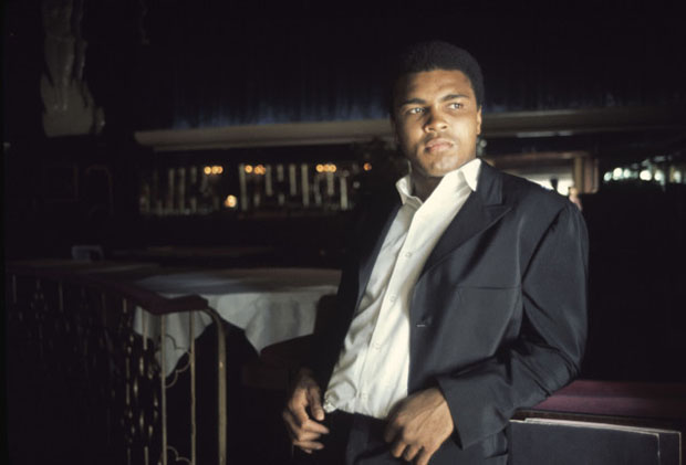 Muhammad Ali in a suit with no tie