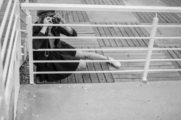 leica cl review - girl in black with camera