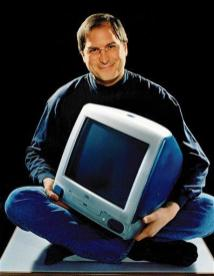 FILE - This 1998 file photo provided by Apple, shows Apple CEO Steve Jobs pose for a photo with an iMac computer. Apple on Wednesday, Oct. 5, 2011 said Jobs has died. He was 56. (AP Photo/Apple, Moshe Brakha, File)