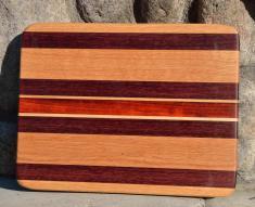 """# 14-28. Red Oak, Purpleheart, Hard Maple and Padauk. 8"""" x 10"""" x 3/4""""."""