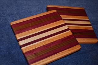 """# 14-30. Red Oak, Purpleheart, Black Walnut and Hard Maple. 9"""" x 11"""" x 1""""."""