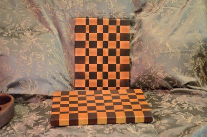 "# 13-01. The Wood Whisperer's design. One is Black Walnut & Yellowheart; the other is Black Walnut & Hard Maple. Edge grain. 12"" x 18"" x 1-1/4""."