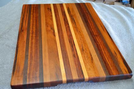 "# 13-08. Alley's cutting board. Goncalo Alves, Jatoba, Honey Locust, Walnut and Cherry. 16"" x 22"" x 1-1/4""."