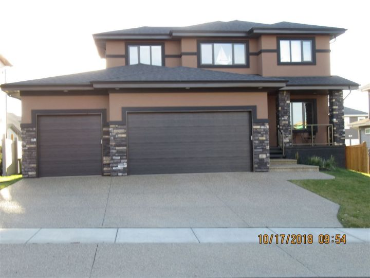 Stamped Driveway, triple garage and all landscaped and fenced.
