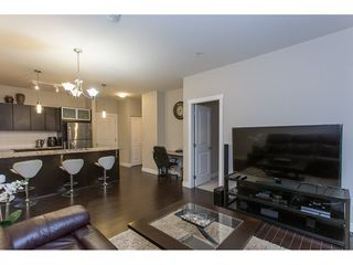 "Photo 10: 211 9655 KING GEORGE Boulevard in Surrey: Whalley Condo for sale in ""GRUV"" (North Surrey)  : MLS®# R2139260"
